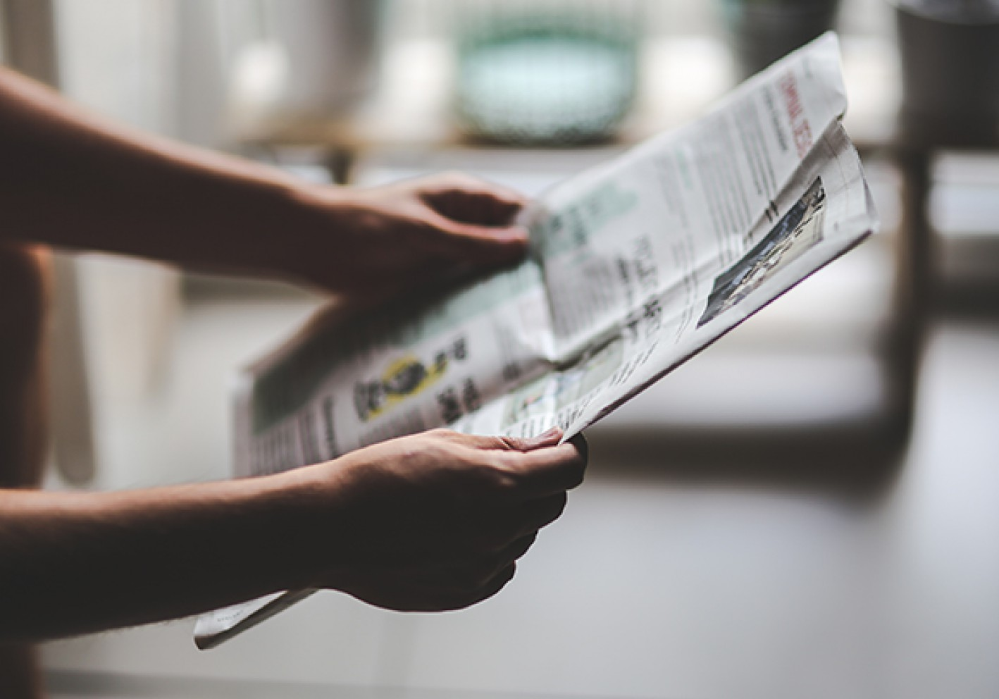 Newspaper in hands